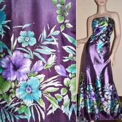 Атлас стрейч темно-фиолетовый, 2-ст. купон в бирюзово-фиолетовые цветы оптом