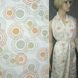 Батист белый в оранжево-салатные круги деворе ш.150