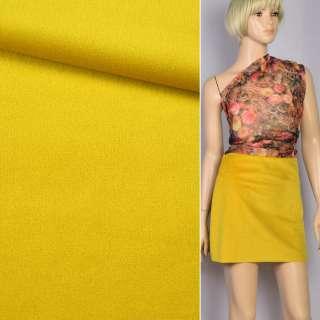 Велюр костюмний жовтий золотистий ш.150 оптом