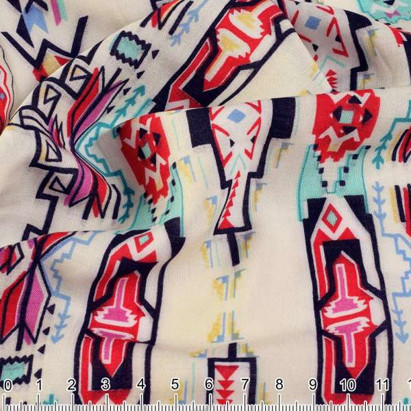 Вискоза купон молочная в бирюзово-красную геометрию ш.143 оптом