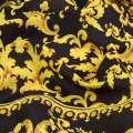 Вискоза черная, желто-оранжевые завитки (купон), ш.145 оптом