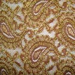 Гипюр стрейч коричневый с огурцами и золотой метанитью ш.150