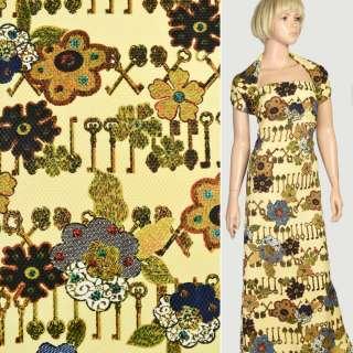 Рогожка соты желтая в коричневые ключи и синие цветы, ш.150 оптом