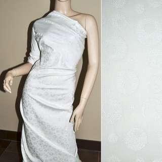 Жаккард костюмный белый с кругами и переливающимся люрексом, ш.150 оптом
