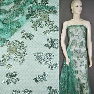 Паутинка бирюзово-зеленая с пайетками и бежевым цветком ш.130 оптом
