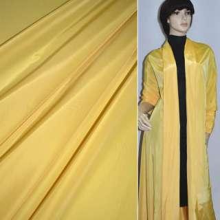 Ткань плащевая желтая ш.150 оптом