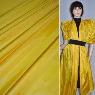 Ткань плащевая блестящая желтая ш.150 оптом