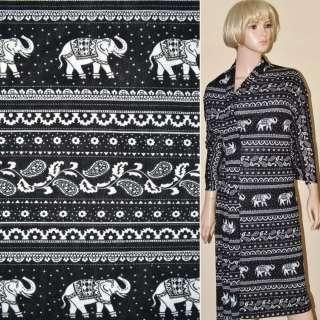 Трикотаж чорний з білими слонами і огірками ш.165 оптом