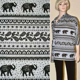 Трикотаж сірий з чорними слонами і огірками ш.170 оптом