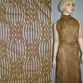 Трикотаж коричневый с ажурными полосками ш.160 оптом