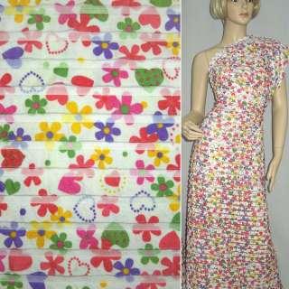 Трикотаж белый с рюшами и цветными цветами ш.150 оптом