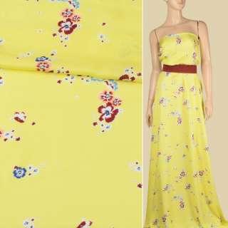 Віскоза атласна лимонно-жовта, дрібні бордово-персикові квіти, ш.140 оптом