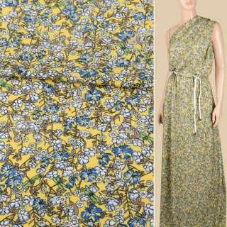 Вискоза желтая, мелкие голубые, белые цветки, ш.140 оптом