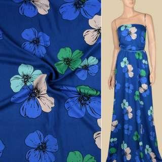 Віскоза синя в зелено-блакитні, бежеві великі квіти, ш.140 оптом