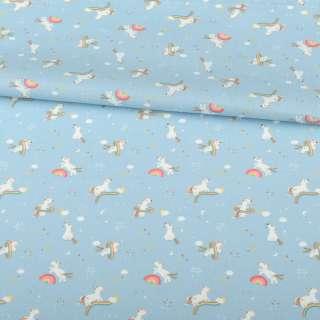 Коттон голубой, белые единороги на радугах, ш.157 оптом