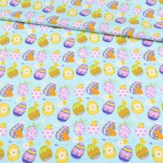 Коттон голубой светлый, желтые, сиреневые пасхальные яйца, ш.147 оптом
