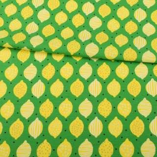 Трикотаж хлопок с эластаном зеленый, желтые лимоны, ш.145 оптом