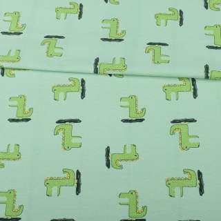 Трикотаж хлопок с эластаном зеленый светлый, зеленые динозаврики, ш.151 оптом