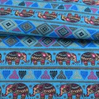 Деко-котон блакитний, орнамент зі слонами, ш.150 оптом