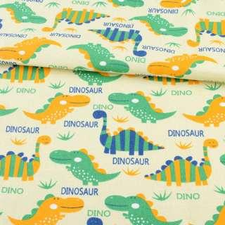Деко-котон кремовий, різнокольорові дінозаврики, ш.150 оптом