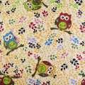 Деко-лен бежевый в сине-желто-бордово-зеленые ветки, совы ш.150 оптом