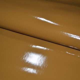 Кожа искусственная лаке на флисе коричневая светлая ш.140 оптом
