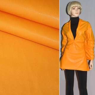 Кожа искусственная желто-оранжевая на флисе ш.140 оптом