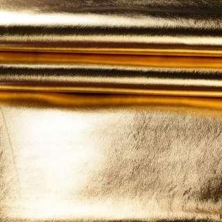 Кожа искусственная золотистая блестящая, ш.140 оптом