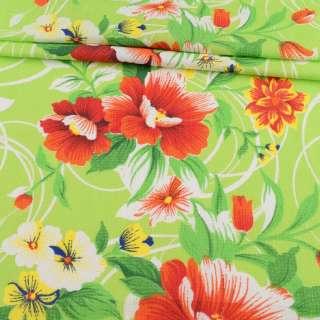 Ткань полотенечная вафельная набивная салатовая в оранжевые цветы, ш.45 оптом