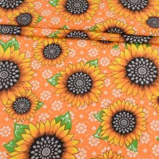 Ткань полотенечная вафельная набивная оранжевая в подсолнухи, ш.45 оптом