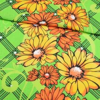 Ткань полотенечная вафельная набивная салатовая с желто-оранжевыми цветами, ш.40 оптом