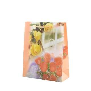 Пакет подарунковий 16х12х6 см з трояндами і парканом персиковий оптом