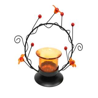 Подсвечник на 1 свечу стакан оранжевый с цветами в круге 14 см металл черный оптом