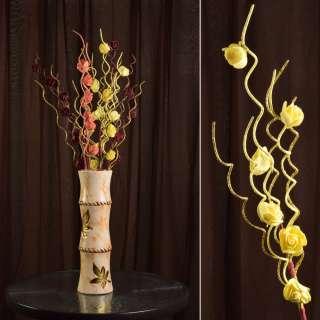 Искусственная веточка 75 см с розочками и золотистой спиралью желтая оптом