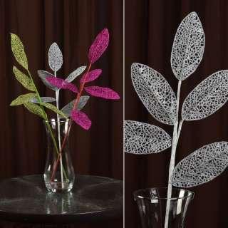 Искусственная веточка 63см с ажурными блестящими листьями серебристая оптом