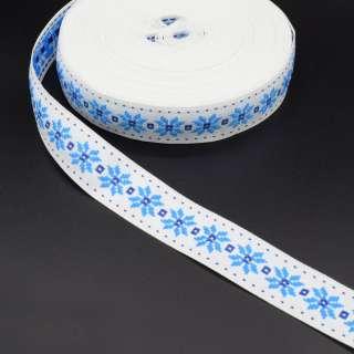 Стрічка оздоблювальна біла з орнаментом 30мм синя 08В28Г27 оптом